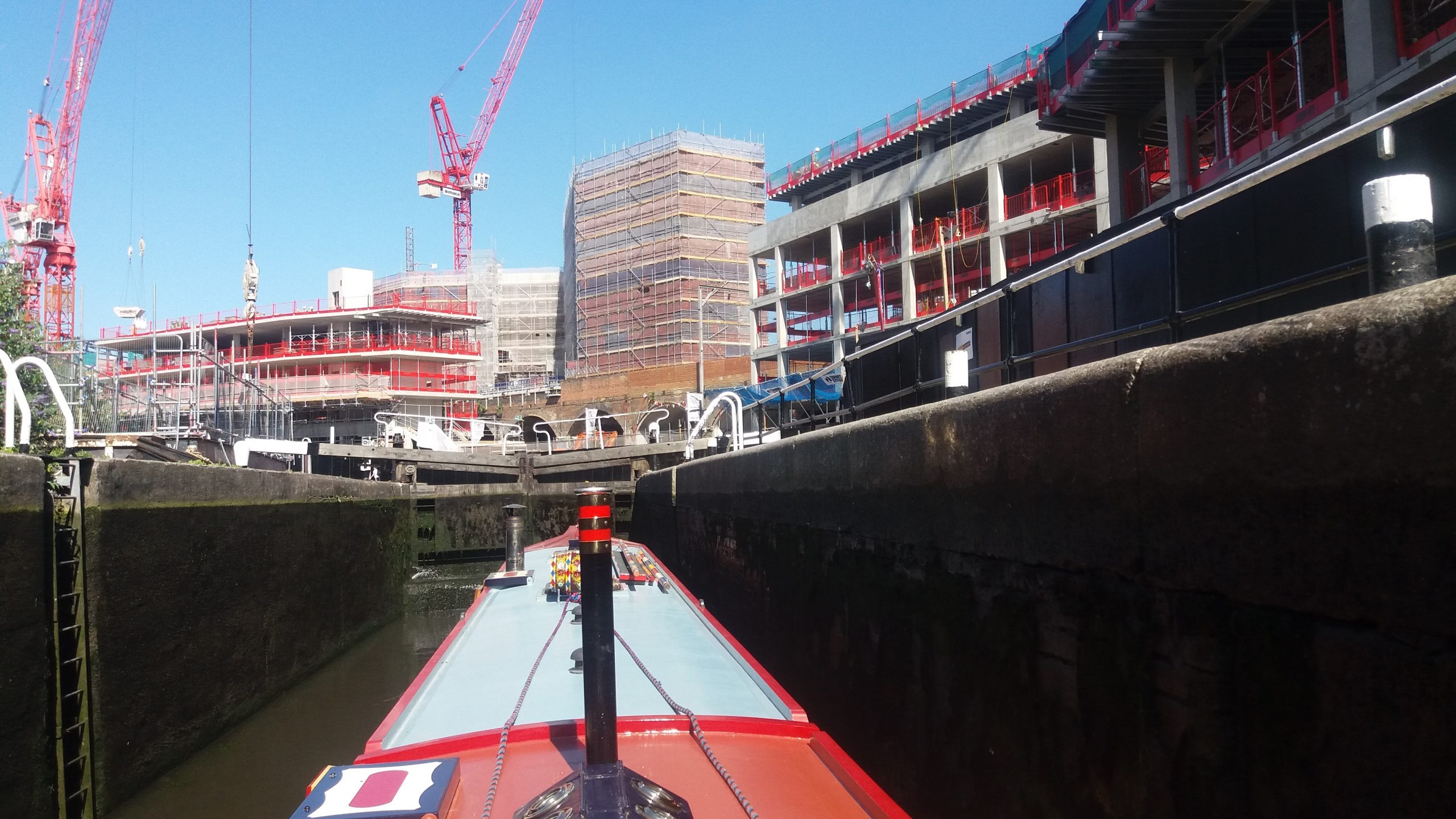 Canal boat moving through the Camden Lock site during construction